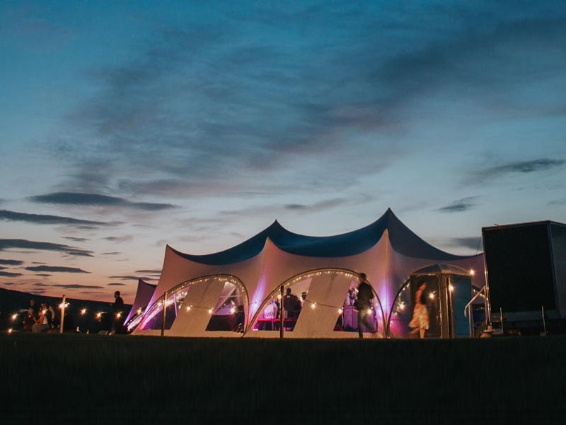 Trapeze marquees at dusk